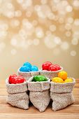Colorful Easter Eggs In Burlap Bags