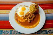 Bolon de verde with fried egg and meat stew ecuadorian food
