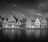 Typical European Europe cityscape view -  canal and medieval houses. Bruges (Brugge), Belgium. Black and white version