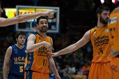 VALENCIA, SPAIN - JANUARY 24: Martin 5, Martinez 17 and Dubljevic 14 during Spanish League match between Valencia Basket Club and UCAM Murcia at Fonteta Stadium on January 24, 2015 in Valencia, Spain