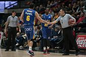 VALENCIA, SPAIN - JANUARY 24: Antelo (6) Kelati (22) and Referee during Spanish League match between Valencia Basket Club and UCAM Murcia at Fonteta Stadium on January 24, 2015 in Valencia, Spain