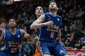 VALENCIA, SPAIN - JANUARY 24: Radovic 11, Aguilar Center, Rojas 27 during Spanish League match between Valencia Basket Club and UCAM Murcia at Fonteta Stadium on January 24, 2015 in Valencia, Spain