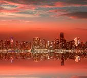 Manhattan New York skyline at sunset dusk from East River NYC USA