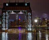 Manhattan New York skyline rainy night from East River floodgates structure USA