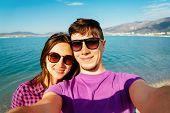 Happy Loving Couple Taking Self-portrait On Beach