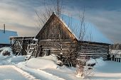 Cottage in the village one snowy morning in Russia