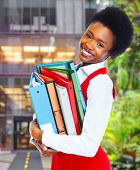 Young african business woman over college background