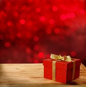 Red  gift box on wooden table