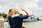 Woman enjoying vacation at German north sea ship pier visiting the Harbor