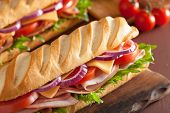 picture of tomato sandwich  - long baguette sandwich with ham cheese tomato and lettuce - JPG