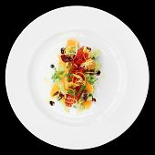 Tuna tartar with cucumber and orange isolated on black background