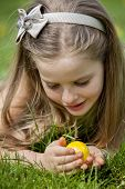 Happy child find easter egg outdoor. Face close up