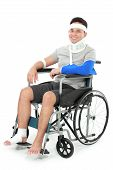 picture of neck brace  - portrait of injured young man sit in wheelchair - JPG