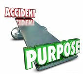 Purpose and Accident opposite words on a balance to illustrate the difference between an intentional, deliberate action and an accident or mistake