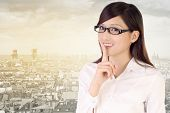 Silent gesture by businesswoman with smile.