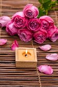 Candles and rose, Petals on mat, Valentines Day background,