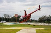 Orlando, Fl, Usa - March 10, 2008: Red Tourist Helicopter Takes Off  For Sightseeing Journey In Orla