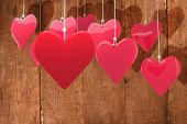 Love hearts against wooden planks