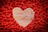 Red love hearts against bleached wooden planks background