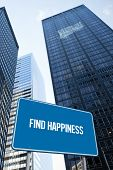 The word find happiness and blue billboard against low angle view of skyscrapers