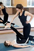 Two Yogi Female Practicing Yoga Therapy In Class