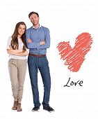Smiling young couple with arms crossed against love heart