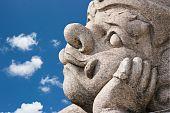 Hanuman Molding Art Looking To Blue Sky With Boring Emotion