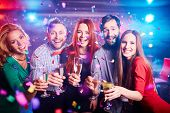 Boozing friends with champagne having party in night club