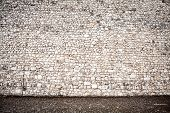 pic of paving stone  - Wall of stones and a stone paving - JPG