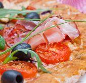 Italian prosciutto and rucola pizza.