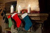 foto of chimney  - Christmas stocking on fireplace background - JPG