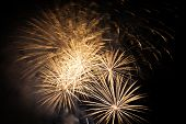Beautiful orange fireworks on a night sky