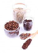 Coffee beans in glass jars isolated on white
