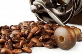 Roasted coffee beans with coffee grinder