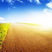 Country asphalt road, blue sky and sunlight.