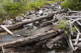 image of hatcher  - Old timbers laying across creek at Independence Mine - JPG