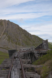 picture of hatcher  - Top view of deteriorating trestle bridge with building at Independence Mine - JPG