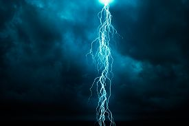 picture of lightning-rod  - Lightning in front of a dark cloudy sky - JPG