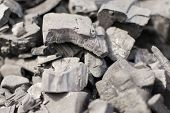 foto of ignite  - Unlit charcoal blocks ready for igniting for food preparation - JPG