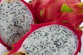 pic of dragon fruit  - dragon fruit slicing on chop block in white background - JPG