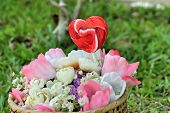 foto of valentine candy  - Candy valentines hearts and artificial flowers with nature - JPG