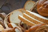 stock photo of fresh slice bread  - Handmade fresh sliced bread in a wicker basket - JPG