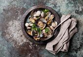 image of clam  - Shells vongole venus clams in metal dish on metal background - JPG