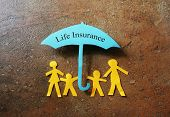 picture of paper craft  - Paper family of four under a Life Insurance paper cutout umbrella - JPG