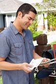 foto of mailbox  - Hispanic Man Checking Mailbox - JPG