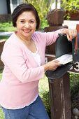 image of mailbox  - Senior Hispanic Woman Checking Mailbox - JPG