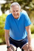 picture of running-late  - Elderly man out for a run - JPG