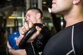 picture of kettlebell  - Kettlebell swing training of two young men in the gym - JPG