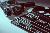 image of shoot out  - Old movie camera with film clapperboard - JPG