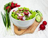 picture of radish  - Spring salad with cucumbers and radish on a wooden background - JPG